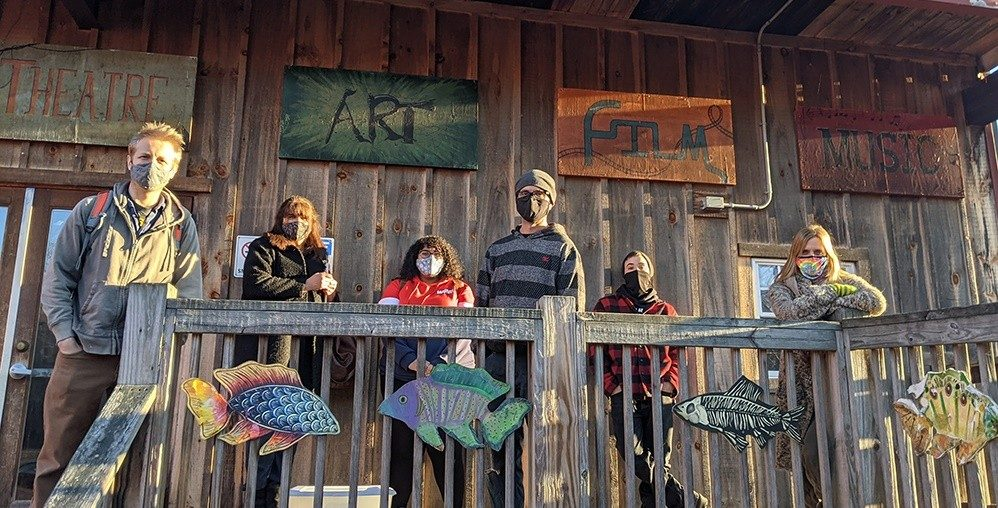 Six staff members of Epoch Arts in East Hampton, CT stand in front of their building.